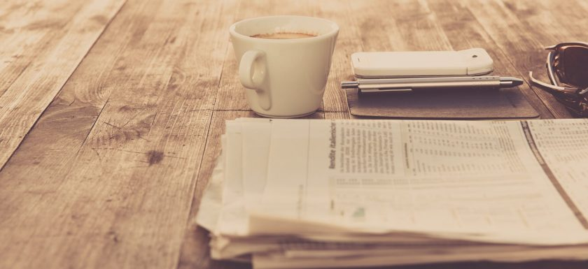 coffee cup smartphone notebook